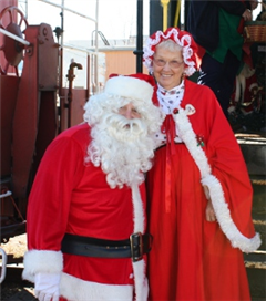 Santa and Mrs. Claus pause for a picture after returning from a trip.